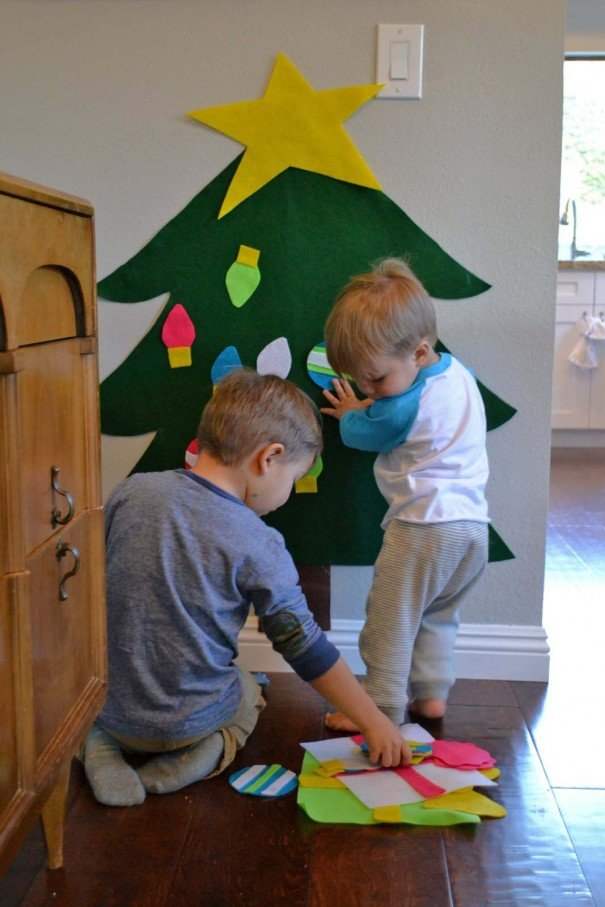 boys playing with tree