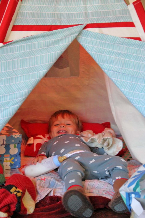 sawyer laughing in teepee